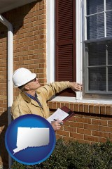 connecticut a building inspector inspecting home windows