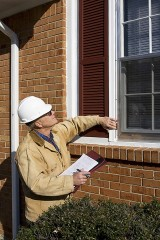 a building inspector inspecting home windows